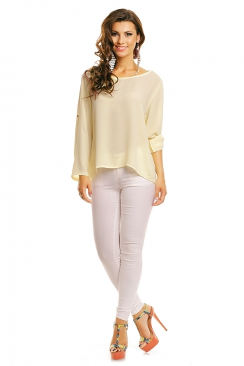 Асиметрична блуза в бледо жълто